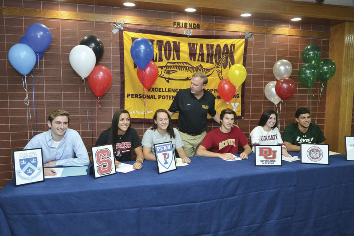Hour Photo/Alex von Kleydorff Wilton Wahoos swim team members, from left, Lexo Walker, Ky -Lee Perry, Emma Holmquist, Hugo Sykes, Kiersten Daly and Luca Di Capua all got together last week to sign their Letters of Intent to swim in college.