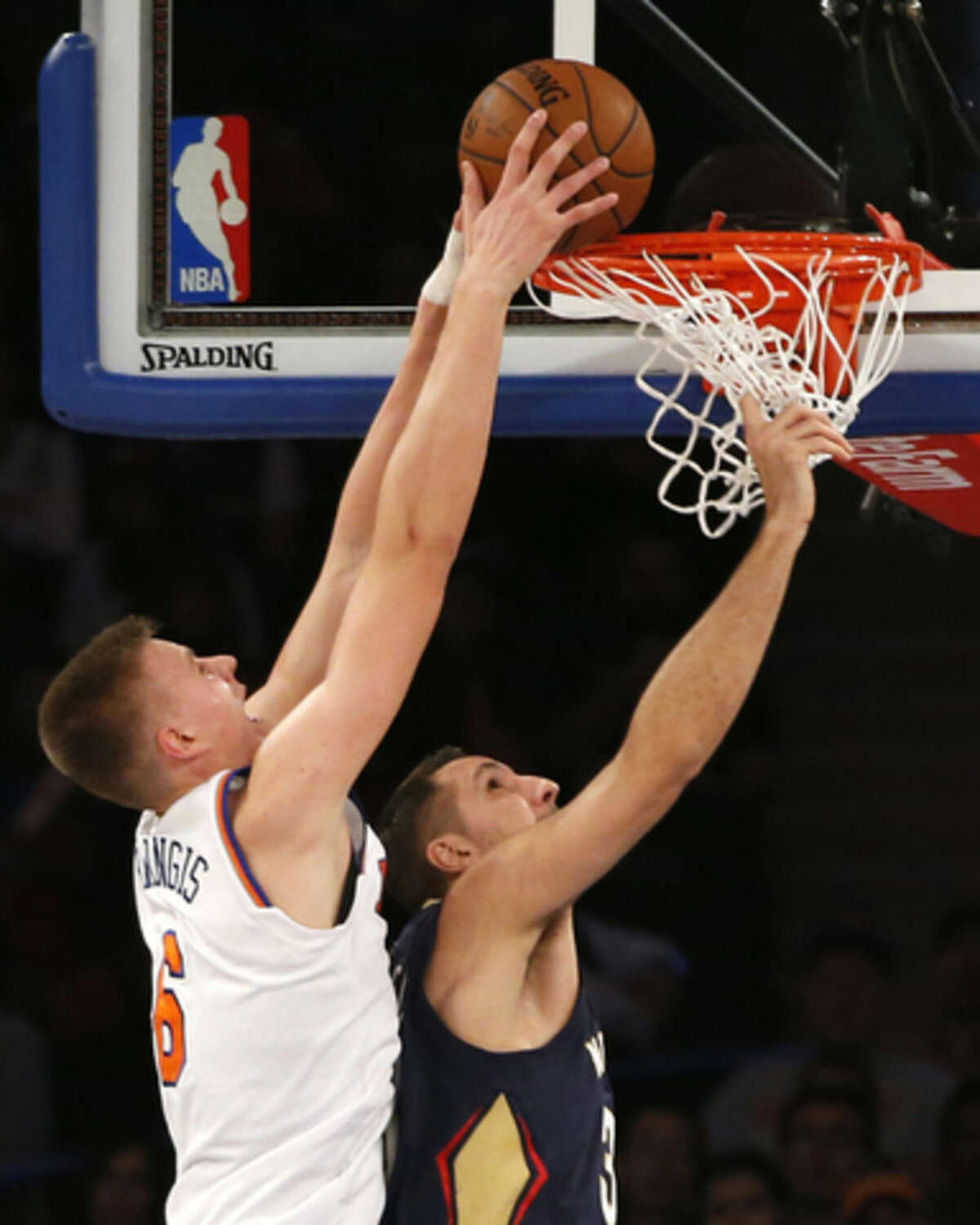 New York Knicks forward Kristaps Porzingis (6) tries to score as New Orleans Pelicans forward Ryan Anderson (33) defends in the first half of an NBA basketball game at Madison Square Garden in New York, Sunday, Nov. 15, 2015. (AP Photo/Kathy Willens)