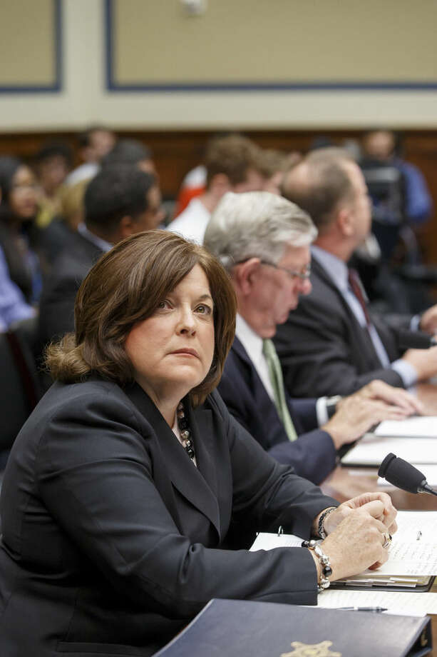 From left, Secret Service Director Julia Pierson, Ralph Basham, a former Secret Service director, and Todd M. Keil, far right, a senior advisor with a private security firm, appear on Capitol Hill in Washington, Tuesday, Sept. 30, 2014, before the House Oversight Committee as it examines details surrounding a security breach at the White House when a man climbed over a fence, sprinted across the north lawn and dash deep into the executive mansion before finally being subdued. (AP Photo/J. Scott Applewhite)