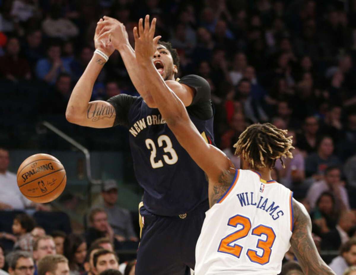 New Orleans Pelicans forward Anthony Davis (23) reacts as he is fouled by New York Knicks forward Derrick Williams (23) in the first half of an NBA basketball game at Madison Square Garden in New York, Sunday, Nov. 15, 2015. (AP Photo/Kathy Willens)