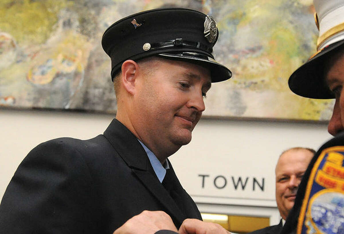 Firefighter Donald Lowndes is the Stamford Fire Department Firefighter of the Year at the awards ceremony Monday night at the Stamford Government Center.