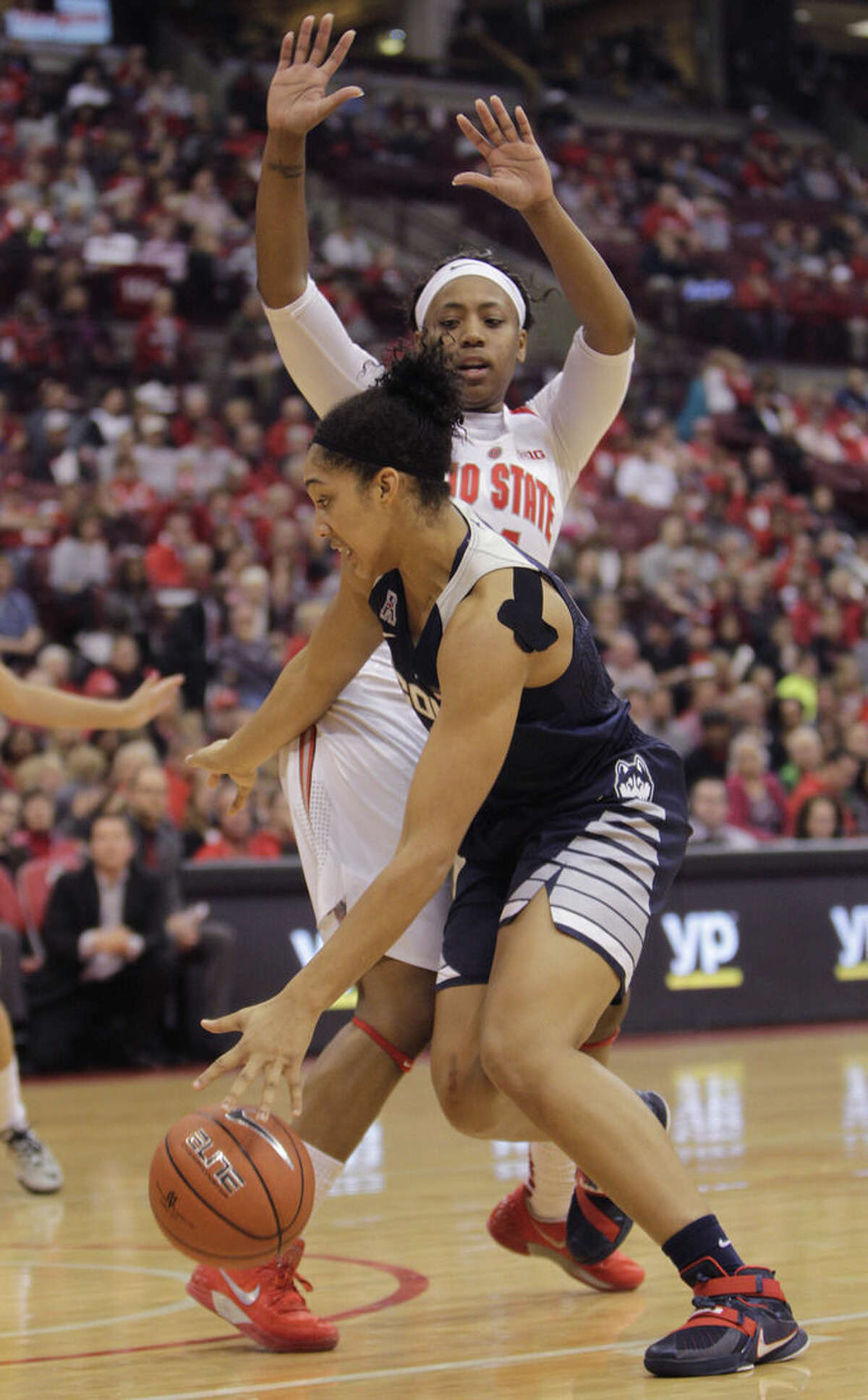 Connecticut's Gabby Williams, front, drives to the basket against Ohio State's Ameryst Alston during the second quarter of an NCAA college basketball game Monday, Nov. 16, 2015, in Columbus, Ohio. (AP Photo/Jay LaPrete)