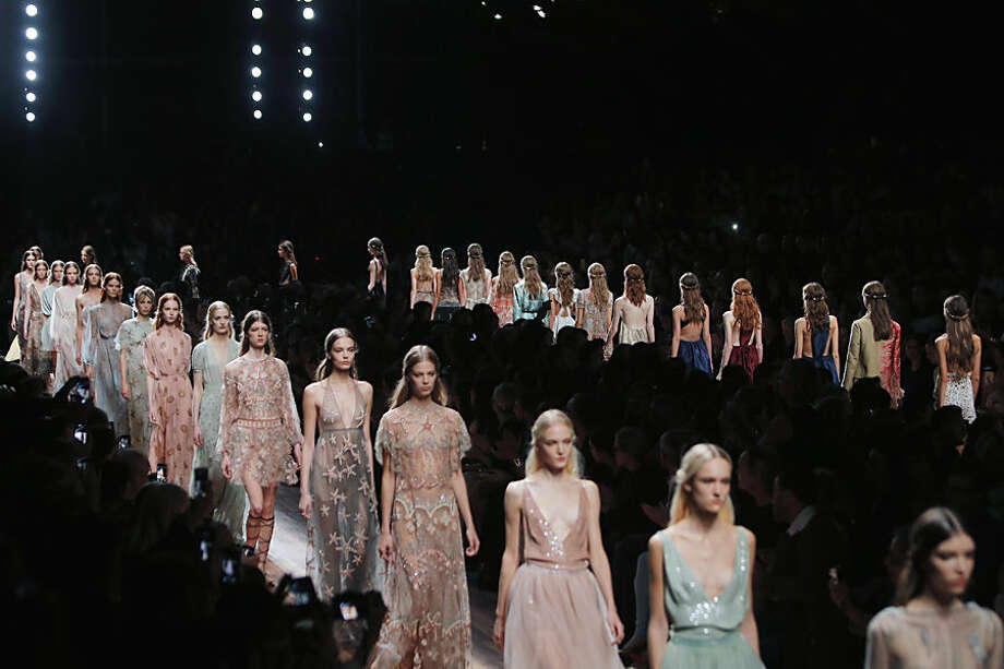Models wear creations for Valentino's Spring/Summer 2015 ready-to-wear fashion collection presented in Paris, France, Tuesday, Sept. 30, 2014. (AP Photo/Thibault Camus)