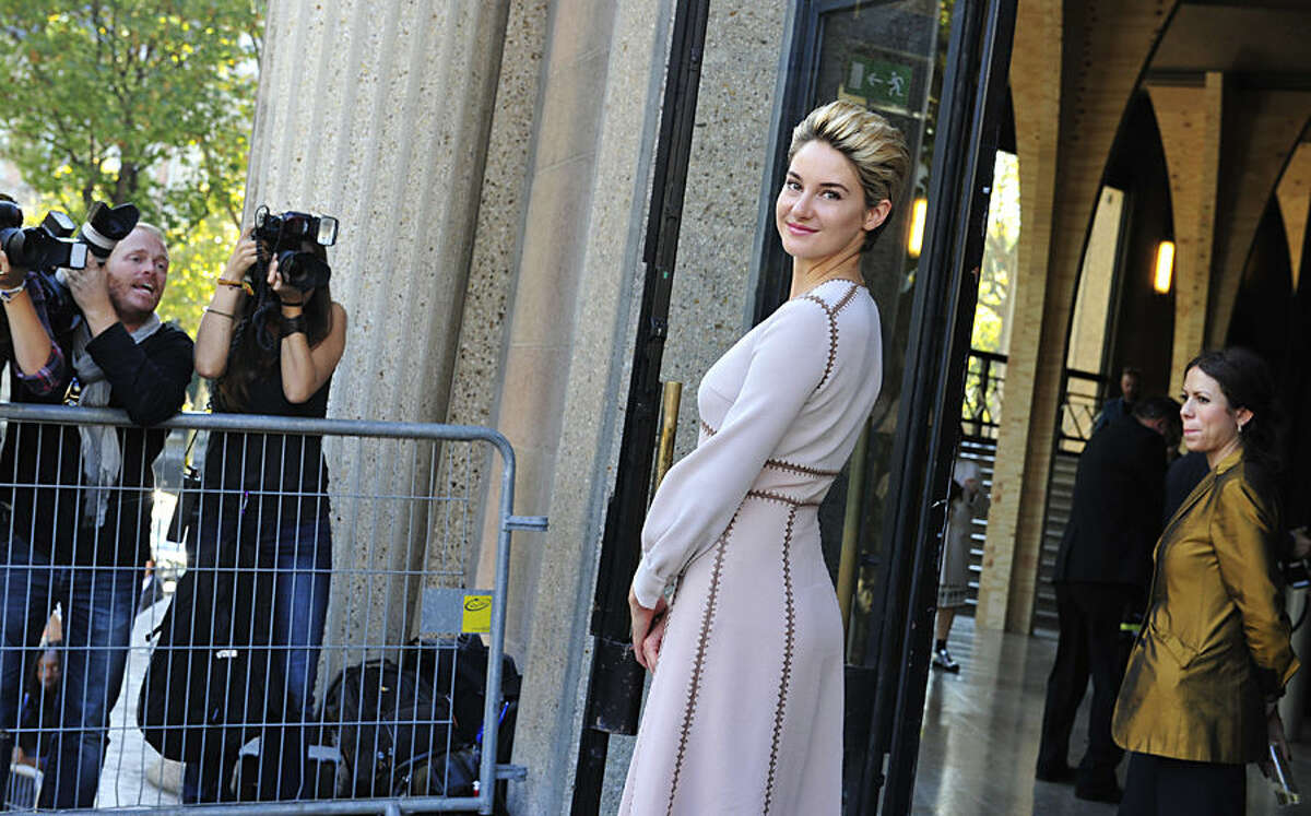 Actress Shailene Woodley poses after Miu Miu's Spring/Summer 2015 ready-to-wear fashion collection presented in Paris, France, Wednesday, Oct. 1, 2014. (AP Photo/Zacharie Scheurer)