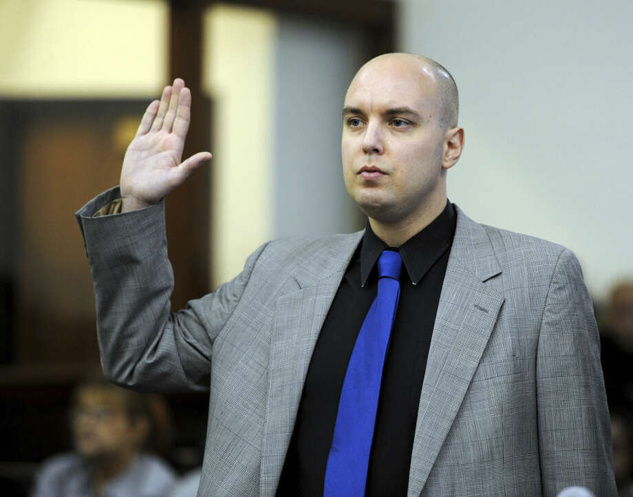 Matthew Mills, of Brooklyn, N.Y., appears before Superior Court Judge William Holden in Bridgeport, Conn., Tuesday, Nov. 17, 2015, on a charge of interfering with police and second-degree breach of peace for allegedly trying to disrupt the annual charity race in honor of murdered Sandy Hook teacher Victoria Soto. (Autumn Driscoll/Hearst Connecticut Media via AP, Pool) MANDATORY CREDIT