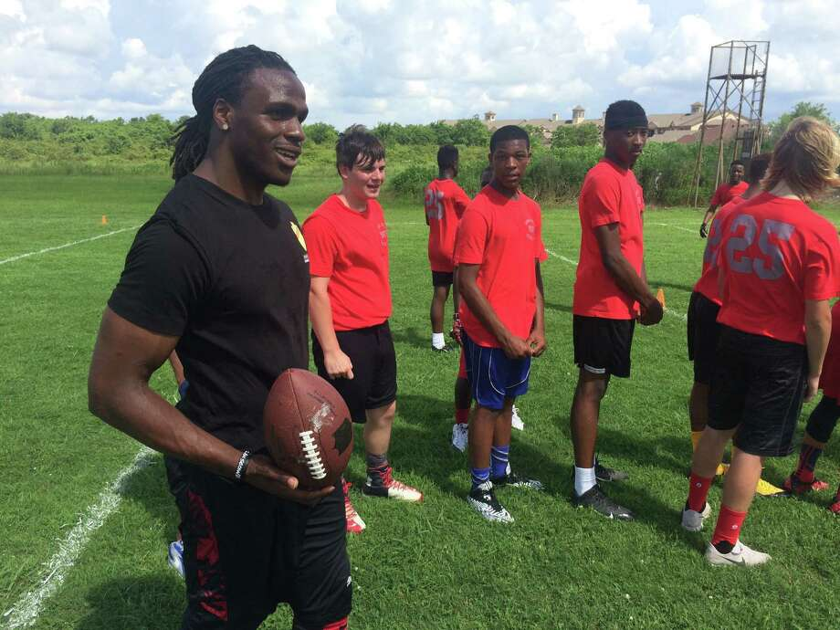 Kansas City Chiefs running back Jamaal Charles watches as a group of youths run through drills during the seventh annual Jamaal Charles football clinic Saturday, June 11, 2016, at Port Arthur Memorial High School. The Memorial High School graduate put on the free camp. Brooks Kubena/The Enterprise Photo: Brooks Kubena/The Enterprise
