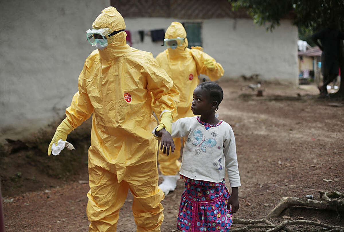 FOR USE AS DESIRED, YEAR END PHOTOS - FILE - Nine-year-old Nowa Paye is taken to an ambulance after showing signs of the Ebola infection in the village of Freeman Reserve, about 30 miles north of Monrovia, Liberia,Tuesday Sept. 30, 2014. (AP Photo/Jerome Delay, File)