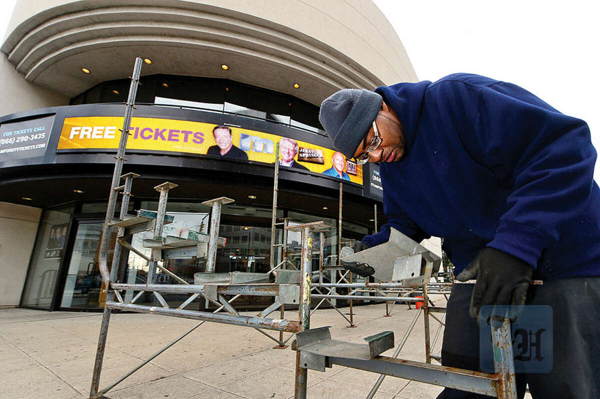 Workers with Lighting and Decorating Inc., including Dwight Smith, set up bleachers along Atlantic Street in Stamford Wednesday in preparation for this weekend's UBS Parade Spectacular.