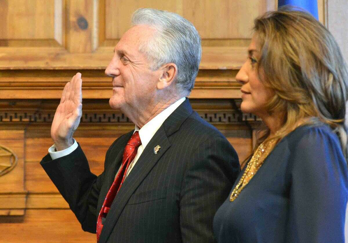 Hour Photo/Alex von Kleydorff Norwalk Mayor Harry Rilling is sworn in by Governor Dan Malloy during a swearing in ceremony at City Hall on Tuesday
