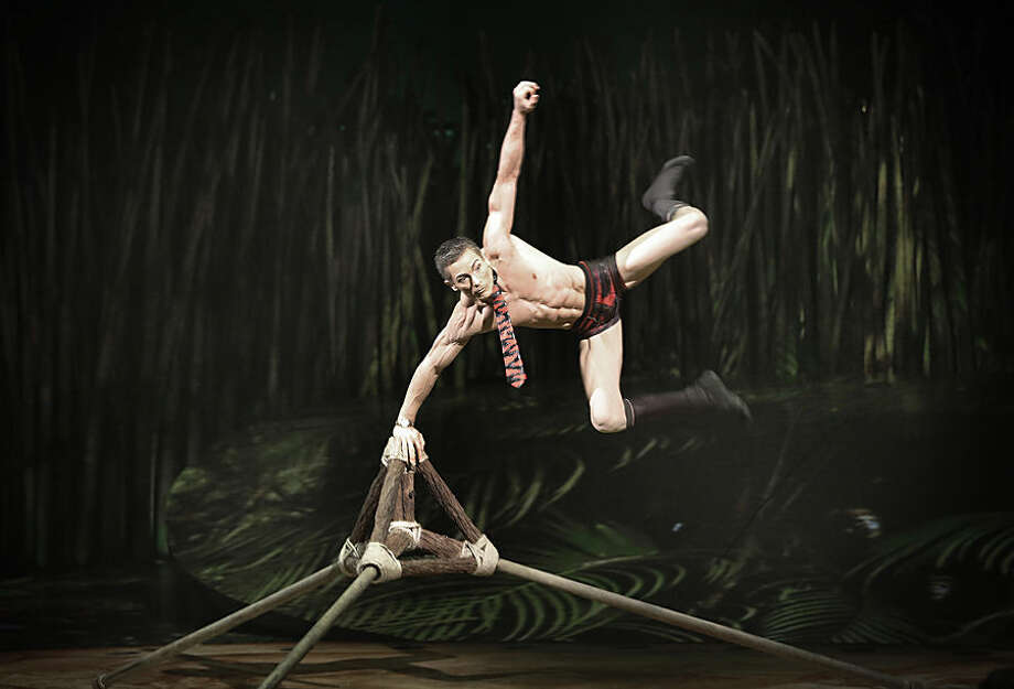 """An artist from Cirque du Soleil re-enacts the evolution of mankind in the production """"Totem"""" on Tuesday, Nov. 17, 2015, in Singapore where they will be performing until the end of the year. (AP Photo/Wong Maye-E)"""