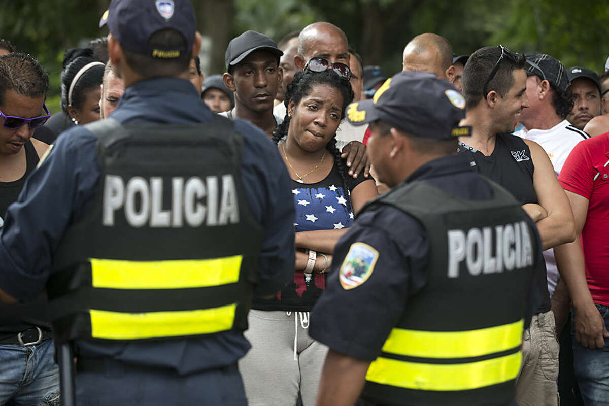 Cuban migrants take part in a protest blocking the Pan-American Highway, demanding access to Nicaragua, in Peñas Blancas, Costa Rica, Tuesday, Nov. 17, 2015. More than 1,000 Cuban migrants heading north to the United States tried to cross the border from Costa Rica into Nicaragua, causing tensions to soar between the neighbors as security forces sought to turn them back. Nicaragua's government responded furiously on Sunday with a statement saying that Costa Rica