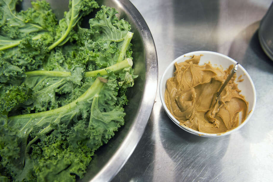 ADVANCE FOR WEEKEND EDITIONS, OCT. 4-5 AND THEREAFTER - In this photo taken Sept. 17, 2014, kale and peanut butter are ready to use at the smoothie bar at the NFL Washington Redskins Players Club cafeteria at Redskins Park in Ashburn, Va. Over the last 13 months, the Redskins have changed the diets of many of its players by converting the basketball and racquetball courts in the Redskins Park basement into a made-to-order, healthy-options eating establishment. There's even a chef with a French cuisine background. (AP Photo/Cliff Owen)