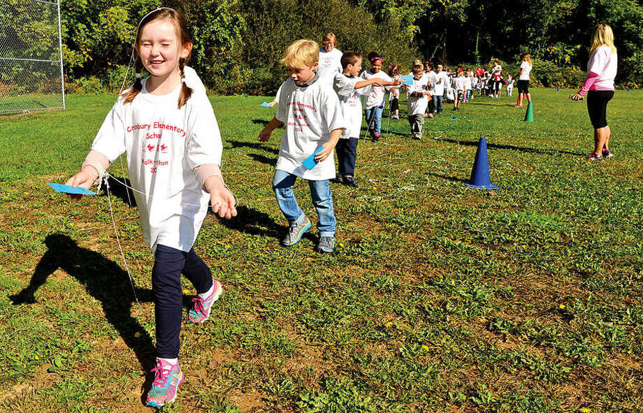 Hour photo / Erik Trautmann Cranbury Elementary School 2nd grader Reese Lincoln and her classmates are sprayed with silly string as they particpate in their school's first annual fundraising Walk-a-Thon. The fundraiser organized by the school's PTO, with participation and pledges driven by the students.