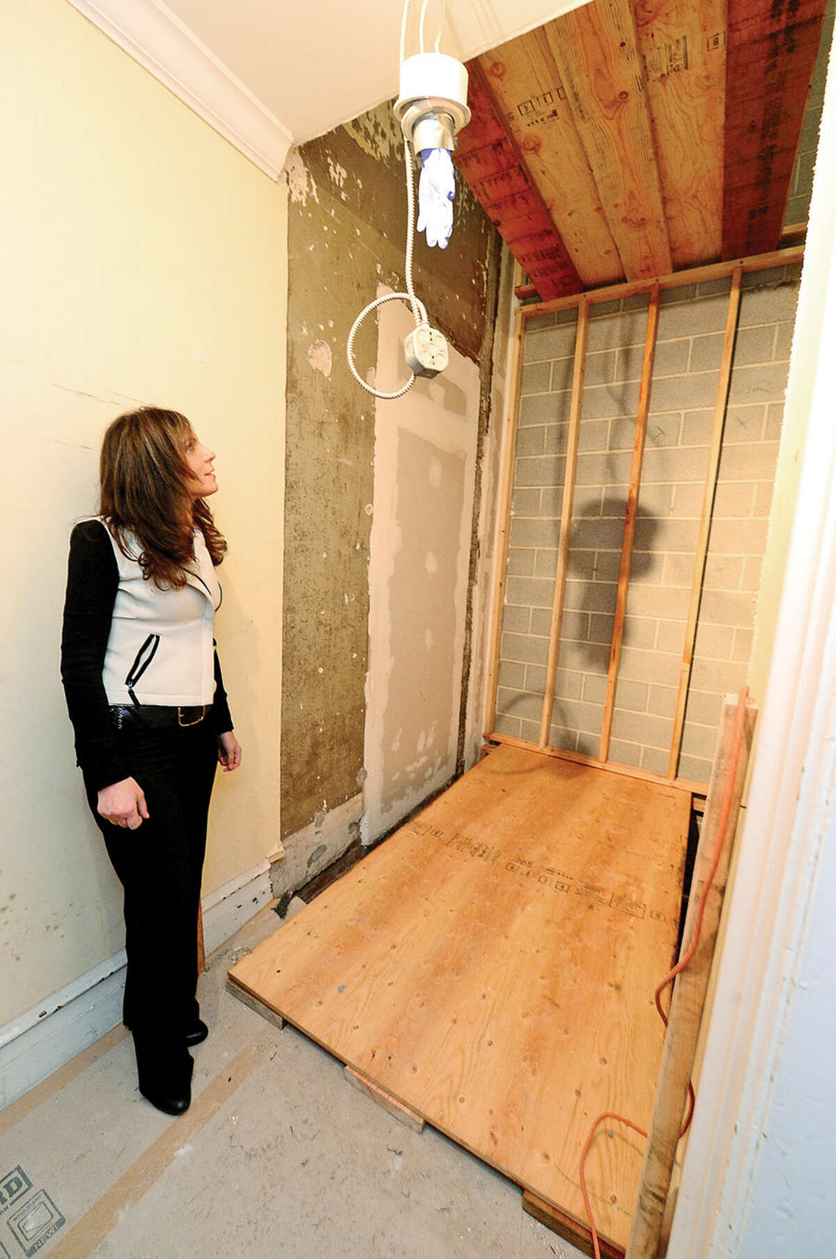 Hour photo / Erik Trautmann Lockwood-Mathews Mansion Museum Executive Director Susan Gilgore looks over Phase Two renovations that includes a project to install an elevator making the new restrooms located in the basement compliant at with the Americans with Disabilities Act.