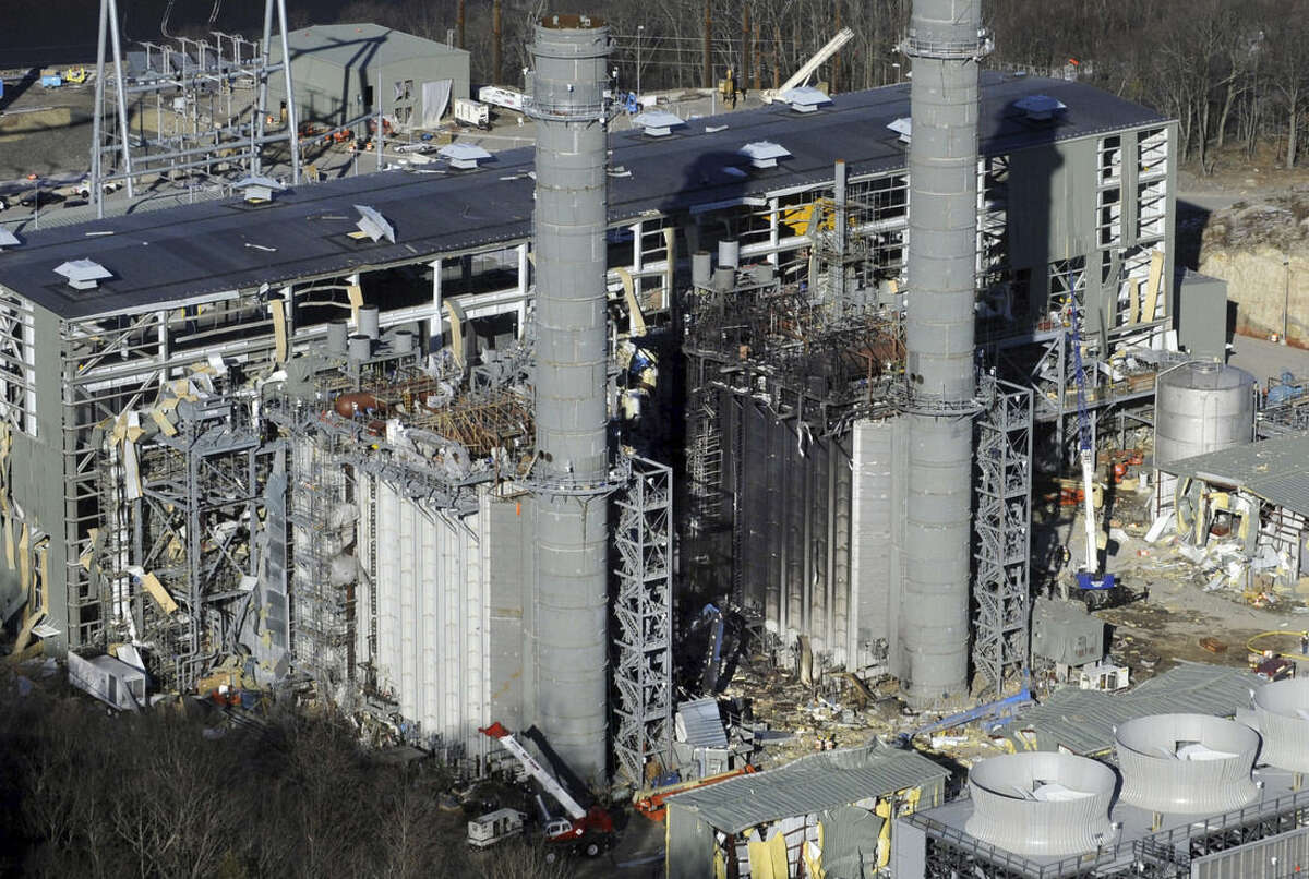FILE - In this Feb. 7, 2010 aerial file photo, damage is visible after an explosion at the Kleen Energy power plant in Middletown, Conn. The Connecticut Supreme Court ruled Wednesday, Nov. 18, 2015, more than 40 workers who weren't injured but who lost their jobs after the explosion cannot sue contractors for hundreds of thousands of dollars in lost wages. (AP Photo/Jessica Hill, File)