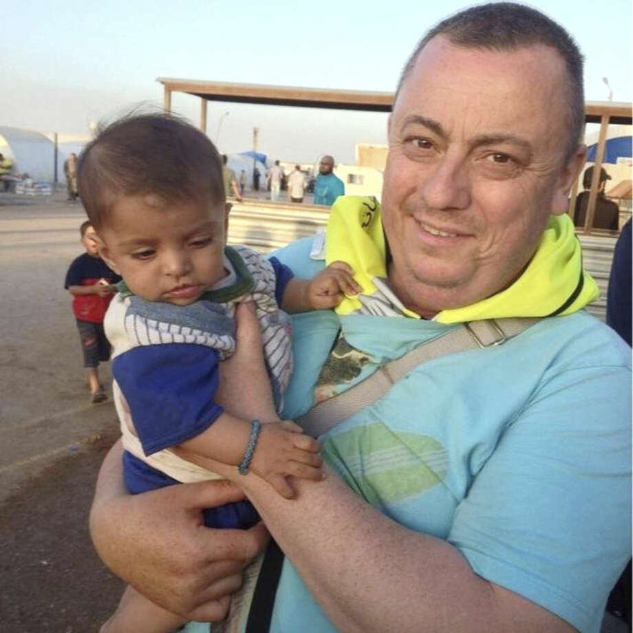 This undated family handout photo shows British man Alan Henning, who was held hostage by the Islamic State group. An Internet video released Friday purports to show an Islamic State group fighter beheading British hostage Alan Henning and threatening yet another American captive, the fourth such killing carried out by the extremist group now targeted in U.S.-led airstrikes. The video mirrored other beheading videos shot by the Islamic State group, which now holds territory along the border of Syria and Iraq. It ended with an Islamic State fighter threatening a man they identified as an American. (AP Photo/PA Wire) UNITED KINGDOM OUT NO SALES NO ARCHIVES