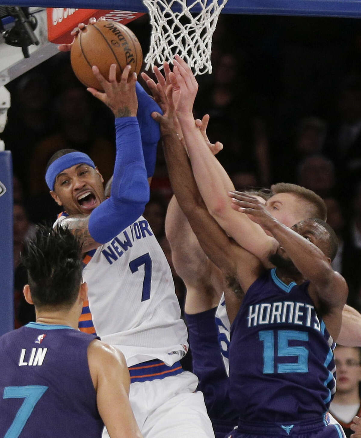 New York Knicks forward Carmelo Anthony (7) grabs a rebound against Charlotte Hornets guard Kemba Walker (15) during the fourth quarter of an NBA basketball game, Tuesday, Nov. 17, 2015, in New York. The Knicks won 102-94. (AP Photo/Julie Jacobson)