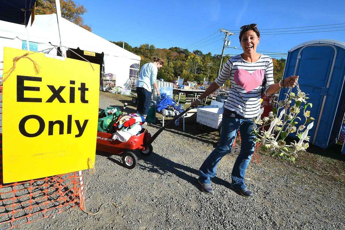 Hour Photo/Alex von Kleydorff At Minks to Sinks in Kelly Magner buys some clothes and a chandelier at Friends and Family day, the sale is this weekend under the tents in Wilton