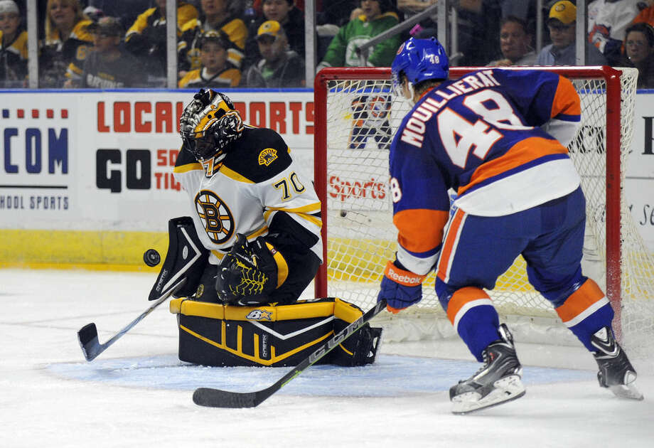 Boston Bruins goalie Malcolm Subban (70) makes a save on New York Islanders center Kael Mouillierat (48) during the second period of a preseason NHL hockey game in Bridgeport, Conn., on Friday, Oct. 3, 2014. (AP Photo/Fred Beckham)