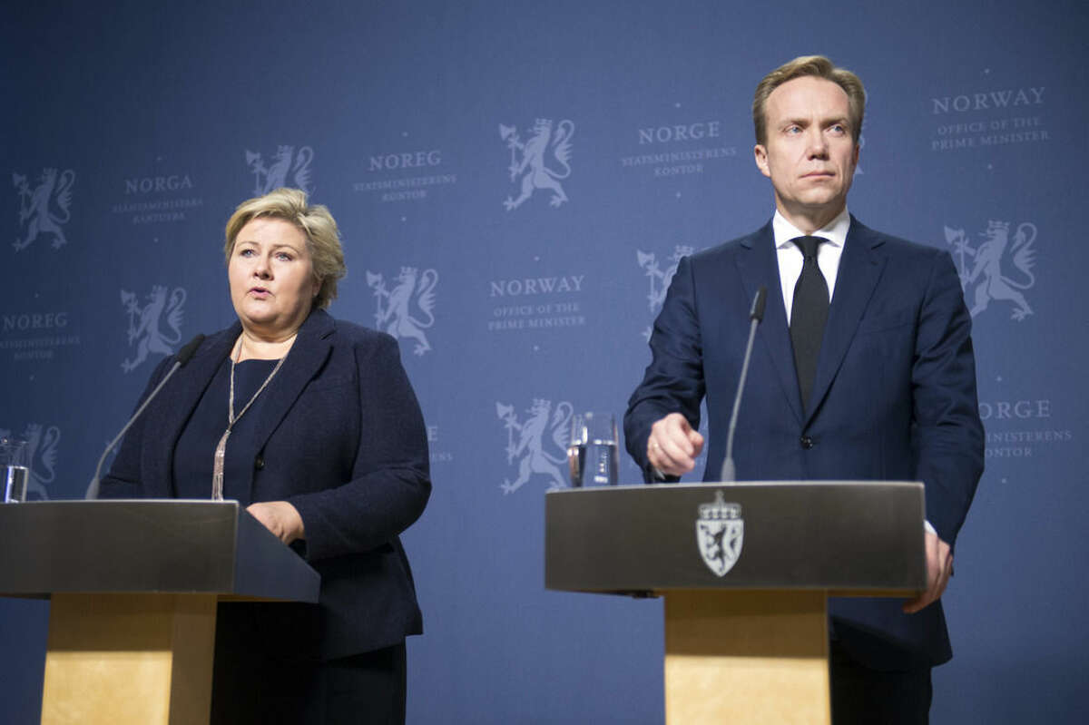 Norway`s Prime Minister Erna Solberg, left and Foreign Minister Borge Brende address the media during a press conference in Oslo, Wednesday, Nov. 18, 2015. The Islamic State group on Wednesday released a picture of the bomb it says downed a Russian passenger plane over Egypt and announced the killing of Norwegian and Chinese hostages in the latest issue of its glossy English-language magazine, which hailed the attacks in France and warned of more violence. The Norwegian man has been identified as Ole Johan Grimsgaard-Ofstad, 48, a graduate student in political philosophy from Porsgrunn, south of Oslo. ( Fredrik Varfjell/NTB scanpix via AP)