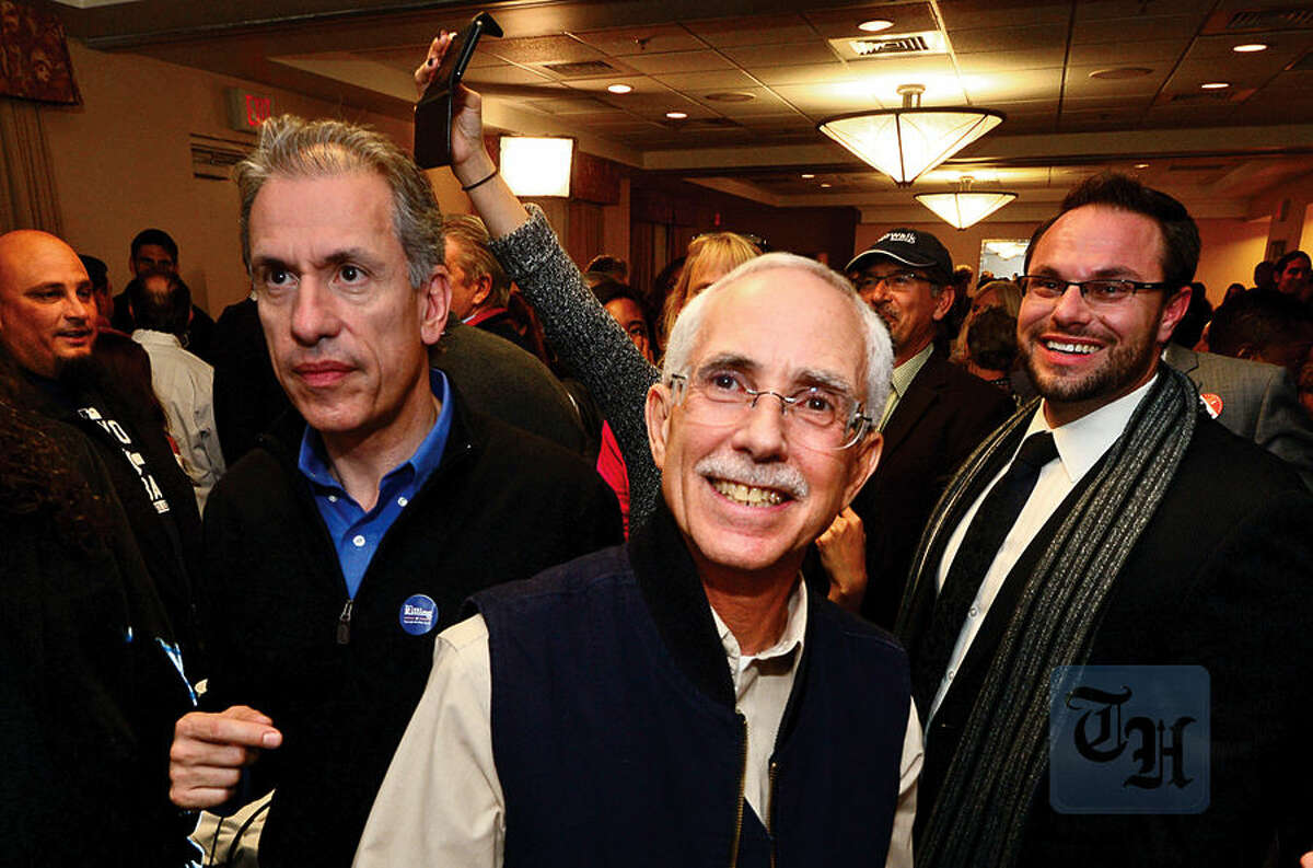 Hour photo / Erik Trautmann Democratic Council at Large candidate Bruce Kimmel smiles as election results come in at the Hilton Garden Inn Tuesday night in Norwalk.