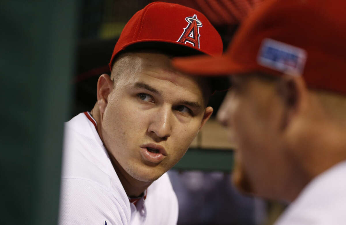 Los Angeles Angels center fielder Mike Trout waits in the dugout before Game 2 against the Kansas City Royals in baseball's AL Division Series, in Anaheim, Calif., Friday, Oct. 3, 2014. (AP Photo/Lenny Ignelzi)