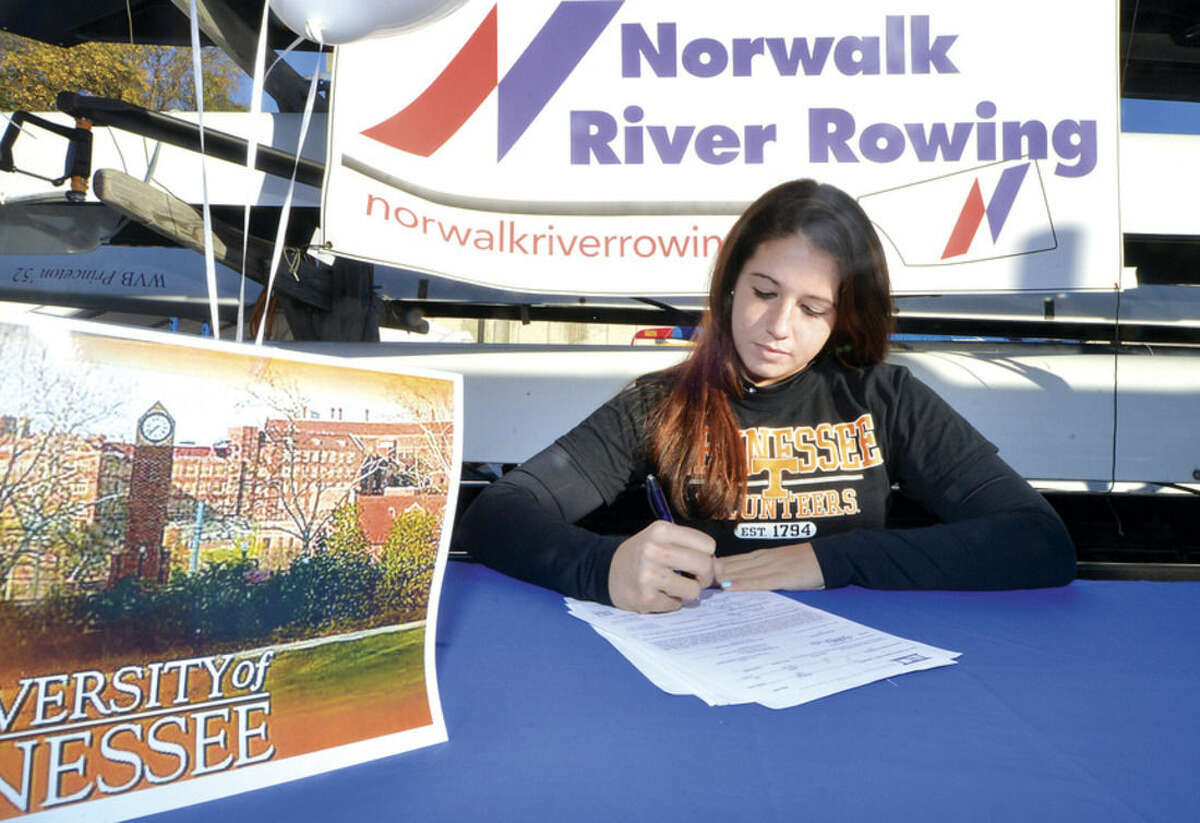 Hour photo/Alex von Kleydorff Jessica Magnoli with Norwalk River Rowing signs her letter of intent to row at the University of Tennessee.
