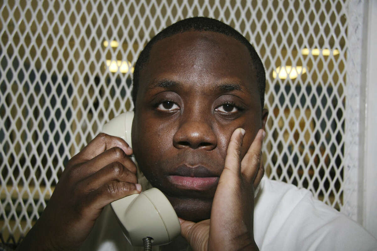 Condemned Texas inmate Raphael Holiday is photographed Oct. 28, 2015, during an interview outside death row at the Texas Department of Criminal Justice Polunsky Unit near Livingston, Texas. Holiday, 36, is set for execution Nov. 18, 2015, for the September 2000 deaths of his 18-month-old daughter, Justice, and her half-sisters, Jasmine DuPaul, 5, and Tierra Lynch, 7. He was convicted of setting a fire that killed the three children at their home in Madison County, Texas. (AP Photo/Michael Graczyk)