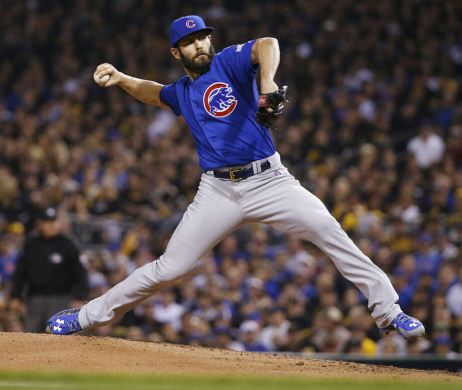 FILE - In this Wednesday, Oct. 7, 2015 file photo, Chicago Cubs starting pitcher Jake Arrieta throws against the Pittsburgh Pirates in the first inning of the National League wild card baseball game in Pittsburgh. Jake Arrieta of the Chicago Cubs has won the NL Cy Young Award, acing out Dodgers stars Zack Greinke and Clayton Kershaw. Arrieta got 17 first-place votes for 169 points from the Baseball Writers' Association of America in results announced Wednesday, Nov. 18, 2015. (AP Photo/Gene J. Puskar, File)