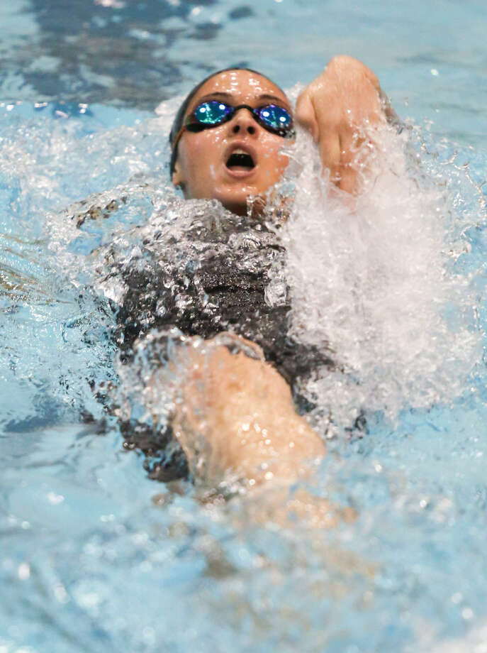 Hour photo/Chris Palermo. Isabel Anbar competes in the backstroke at the CIAC swim championships at Southern Connecticut State University Tuesday night.