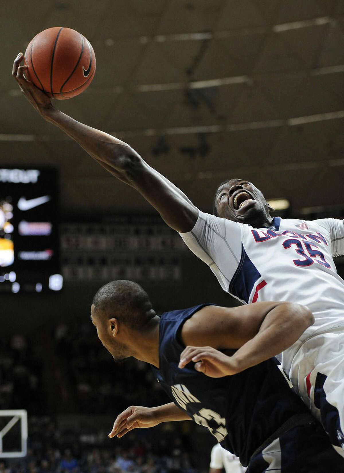 Connecticut's Amida Brimah grabs an offensive rebound over New Hampshire's Ronnel Jordan, left, in the first half of an NCAA college basketball game, Tuesday, Nov. 17, 2015, in Storrs, Conn. (AP Photo/Jessica Hill)