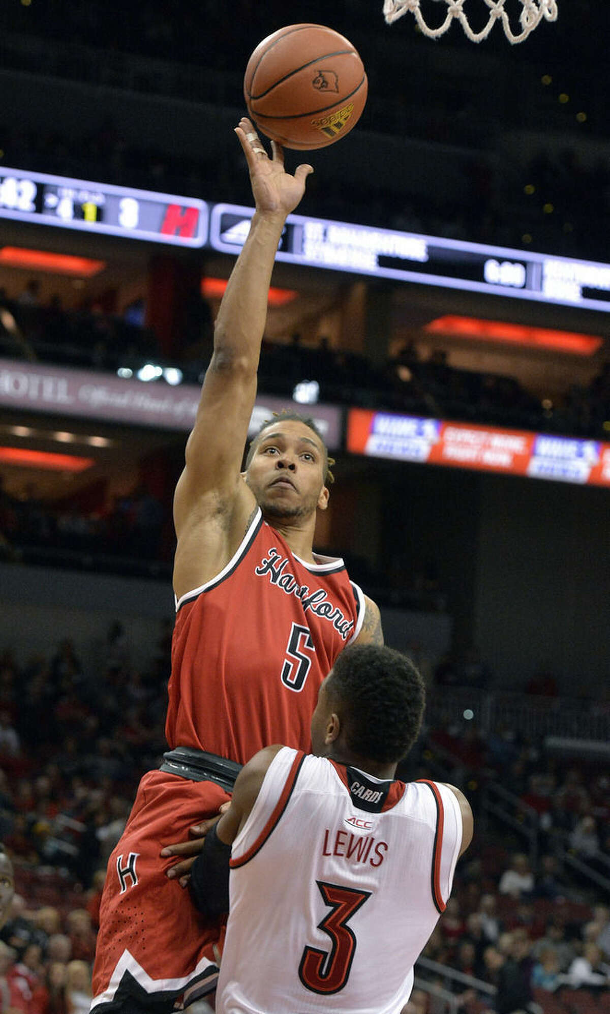 Hartford's Pancake Thomas (5) puts a shot up over the defense of Louisville's Trey Lewis (3) during the first half of an NCAA college basketball game, Tuesday, Nov. 17, 2015, in Louisville, Ky. (AP Photo/Timothy D. Easley)
