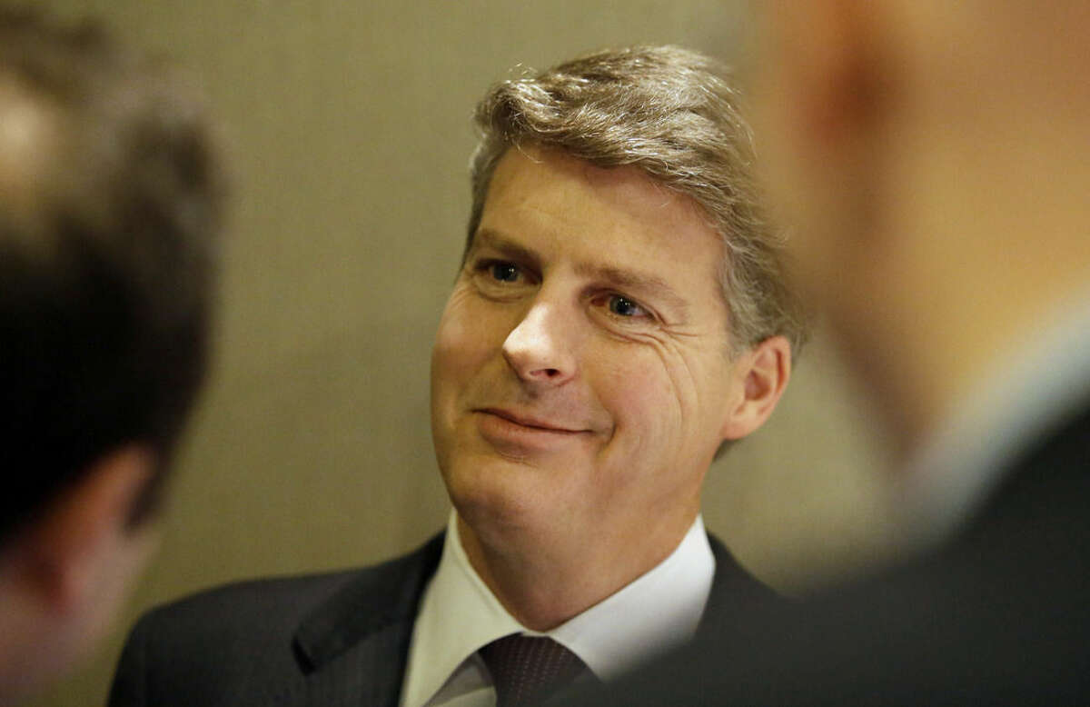 New York Yankees owner Hal Steinbrenner smiles as he listens to a question while speaking with reporters in the lobby of the hotel hosting the baseball owners meeting, Wednesday, Nov. 18, 2015, in Dallas. (AP Photo/LM Otero)