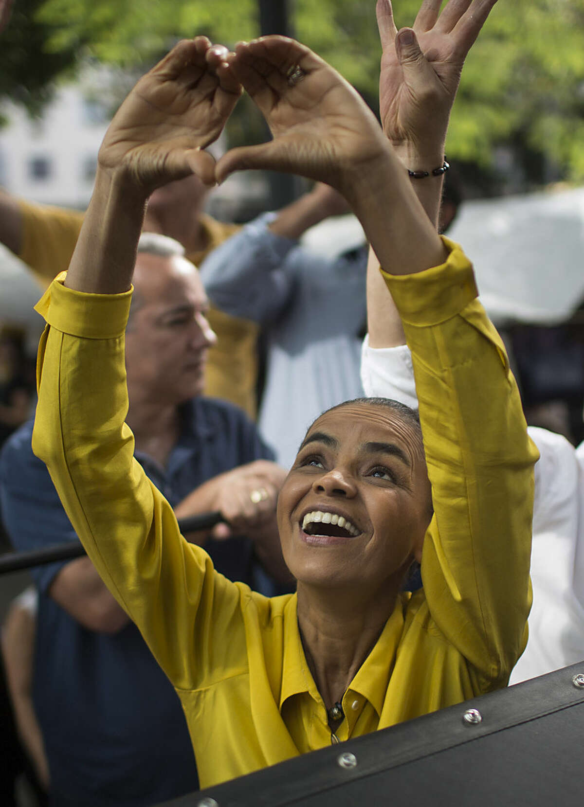 Marina Silva, presidential candidate of the Brazilian Socialist Party, PSB, greets supporters at a campaign rally in Rio de Janeiro, Brazil, Friday, Oct. 3, 2014. Silva, who grew up as one of eight children of an impoverished rubber tapper on a plantation deep in Brazil's Amazon, went on to become a local lawmaker, senator, and then Environment Minister during the presidency of President Luiz Inacio Lula da Silva. Today Silva is running for president in Brazil's Oct. 5 general elections. (AP Photo/Felipe Dana)