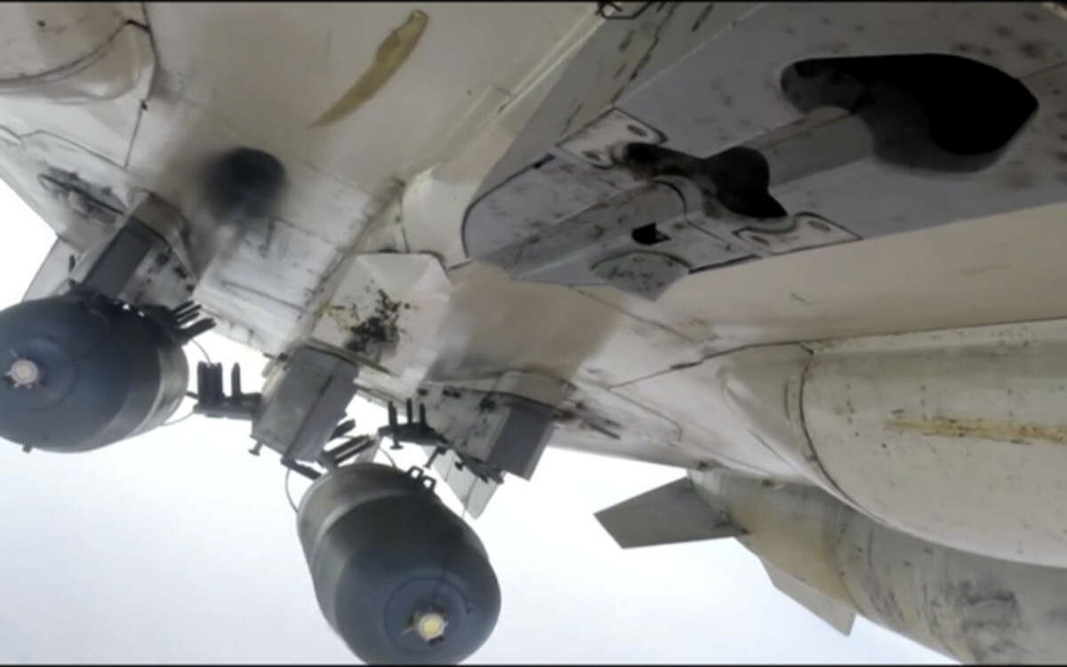 This photo made from footage taken from Russian Defense Ministry official website Tuesday, Nov. 17, 2015, shows a Russian Su-24M during a Russian air raid in Syria. Islamic State militants are barricading down for a possible assault on their de facto capital Raqqa, hiding among civilian homes and preventing anyone from fleeing, as international airstrikes intensify on the Syrian city in the wake of the Paris attacks. For many, the threat of missiles and bombs from the enemies of Islamic State is more of an immediate threat than the vicious oppression of the jihadis' themselves. (Russian Defense Ministry Press Service via AP)