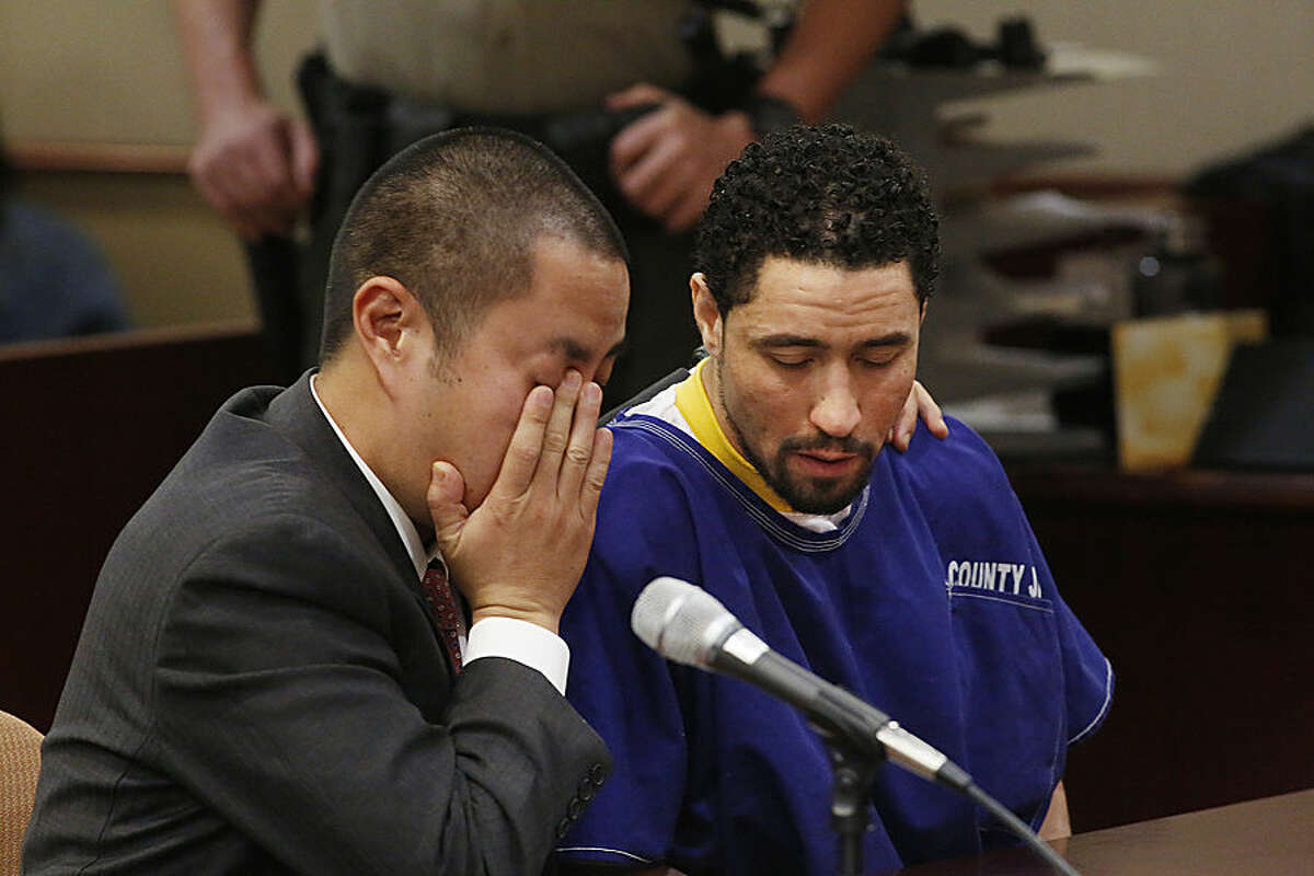 Defense attorney Al Kim, left, and Alex Jackson react as Jackson's brother Vincent Jackson pleads for leniency during the sentencing of Alex after his conviction for second-degree murder of Pamela Devitt, in Los Angeles County Superior Court in Lancaster, Calif., on Friday, Oct. 3, 2014. Devitt, 63,was mauled by Jackson's pit bulls as she was on her morning walk on May 9, 2013. (AP Photo/Los Angeles Times, Anne Cusack, Pool)