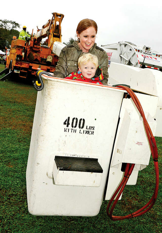 Hour photo / Erik Trautmann Alison Langenus and her son, Jack, 2, go up in a Connecticut Light and Power bucket truck during the Human Services Council's third annual KIDZFEST Touch-A-Truck Fundraiser to benefit Children's Connection Saturday at Taylor Farm Park. KIDZFEST raises funds to support Children's Connection, a nationally accredited Children's Advocacy Center that works to identify, substantiate, and treat cases of sexual and severe physical abuse while working toward its mission of creating a world where no child is harmed and no family is left without guidance.