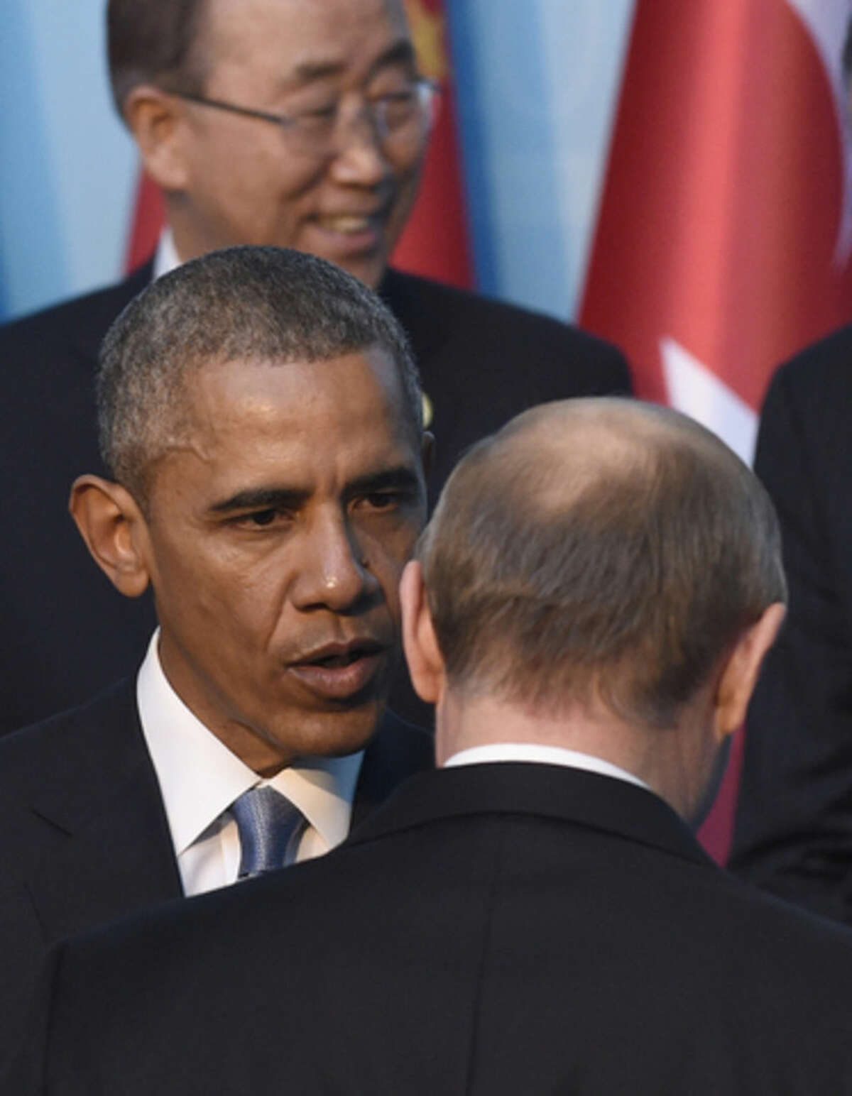 In this Sunday, Nov. 15, 2015, file photo, US President Barack Obama, left, talks with Russia?s President Vladimir Putin, as they arrive for a group photo with other leaders for the G-20 Summit in Antalya, Turkey. For President Vladimir Putin, the terror attacks in Paris marked a watershed moment in relations with the West. This week's summit in Turkey made it clear that the U.S. and its allies have warmed to the idea of closer ties with Russia, whose help they need to confront the challenge of the Islamic State group. (AP Photo/Susan Walsh, File)