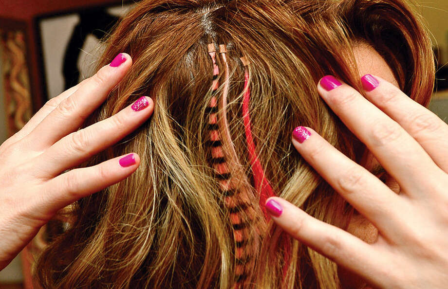 Hour photo / Erik Trautmann SoNo Academy is promoting pink hair extensions to show support for Breast Cancer Awareness Month and donating a portion of its proceeds to Smillow Family Breast Health Center of Norwalk Hospital.