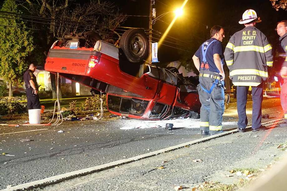 Hour photo/Jeff DaleNorwalk Police and Fire respond to a rollover in the vicinity of 3 Calf Pasture Beach Road Friday night.
