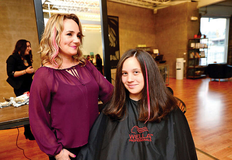Hour photo / Erik Trautmann SoNo Academy owner Thea Tsiranides is promoting pink hair extensions for customers like Sarah Laguardia to show support for Breast Cancer Awareness Month and donating a portion of its proceeds to Smillow Family Breast Health Center of Norwalk Hospital.