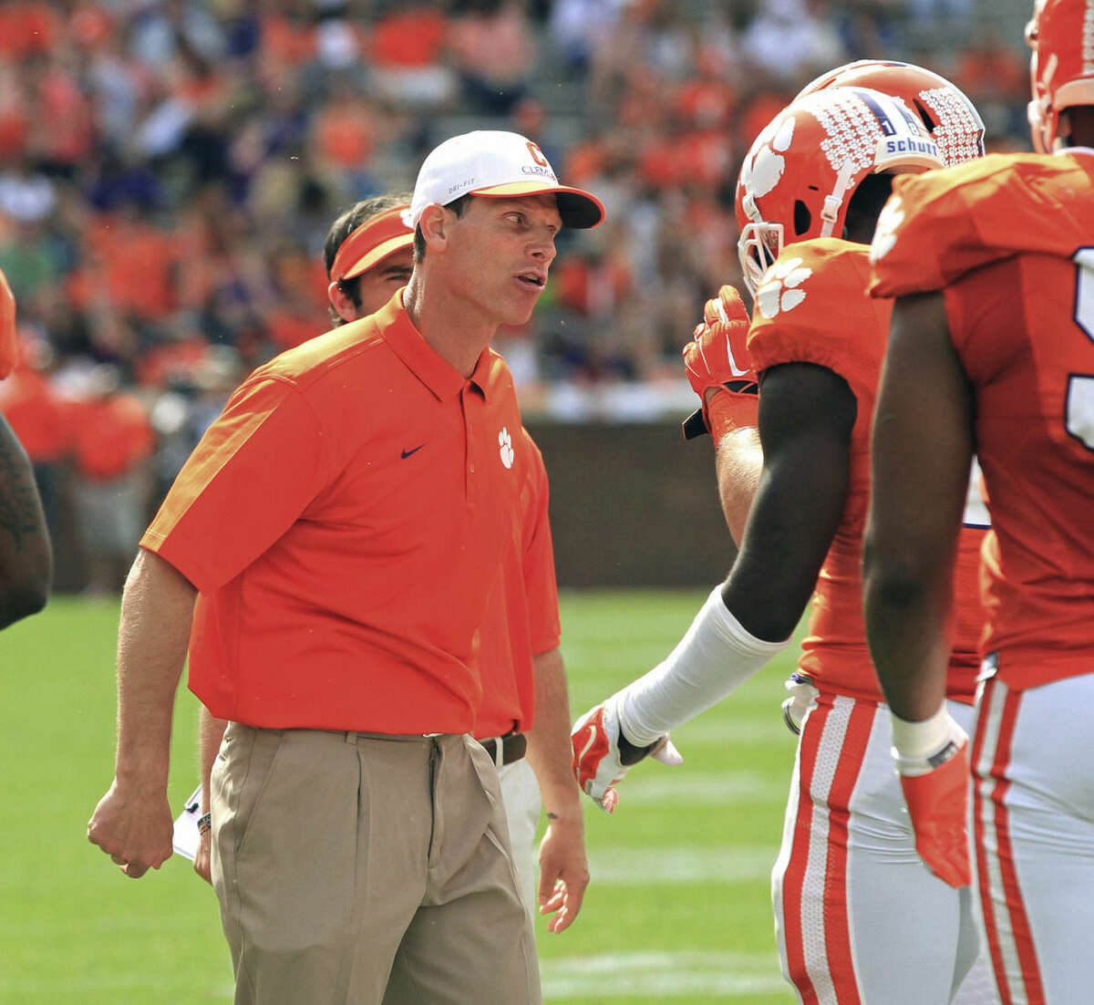 FILE - In this April 11, 2015, file photo, Clemson defensive coordinator Brent Venables, left, gets on a player during Clemson's NCAA college football spring game at Memorial Stadium in Clemson, S.C. Clemson's top-ranked defense came at teams in waves last season, smothering opponents with nearly two full units of talented and experienced players. Without that same depth this year, the Tigers have slipped into a late-season slump. (Mark Crammer/Anderson Independent-Mail via AP, File)