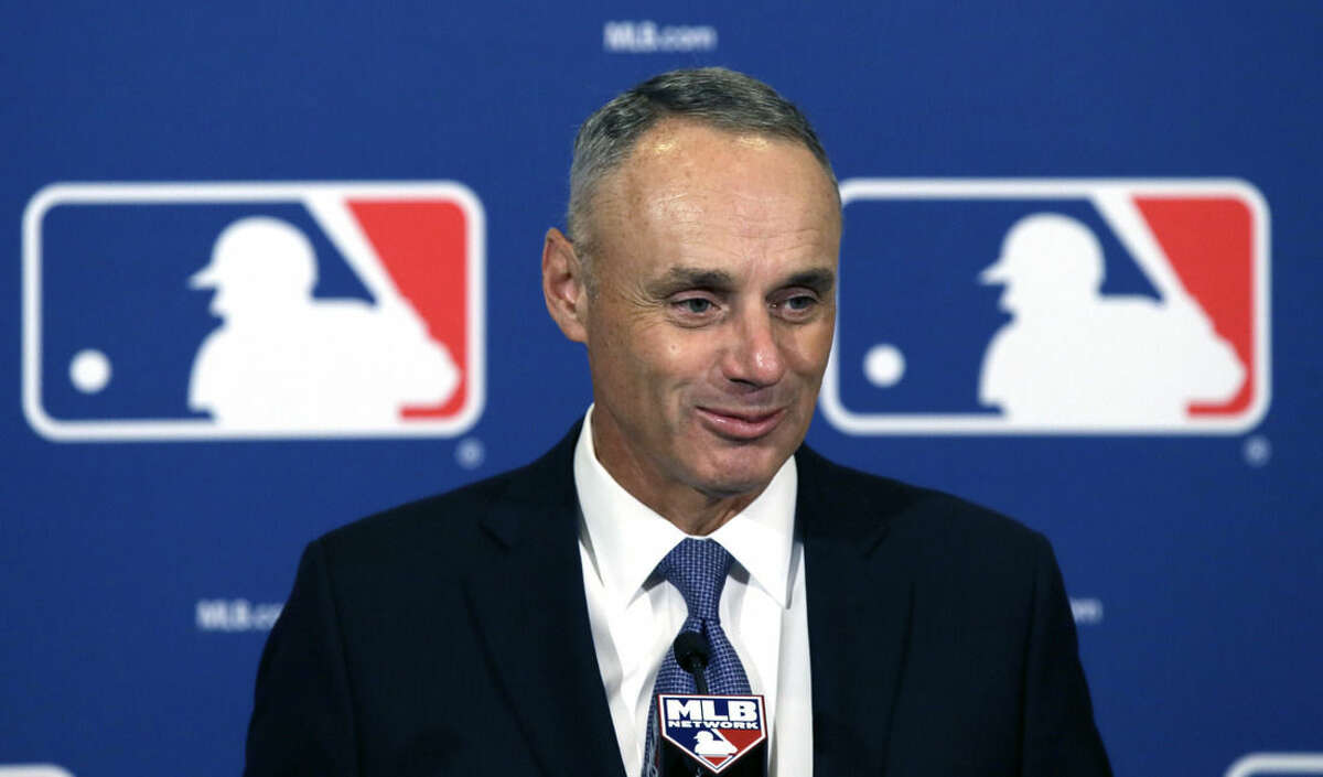 Major League Baseball Commissioner Rob Manfred speaks during a news conference after wrapping up the MLB owners meeting, Thursday, Nov. 19, 2015, in Dallas. Major League Baseball is close to new recommendations for safety netting at its stadiums for the 2016 season. Commissioner Manfred says fan safety is paramount and it is
