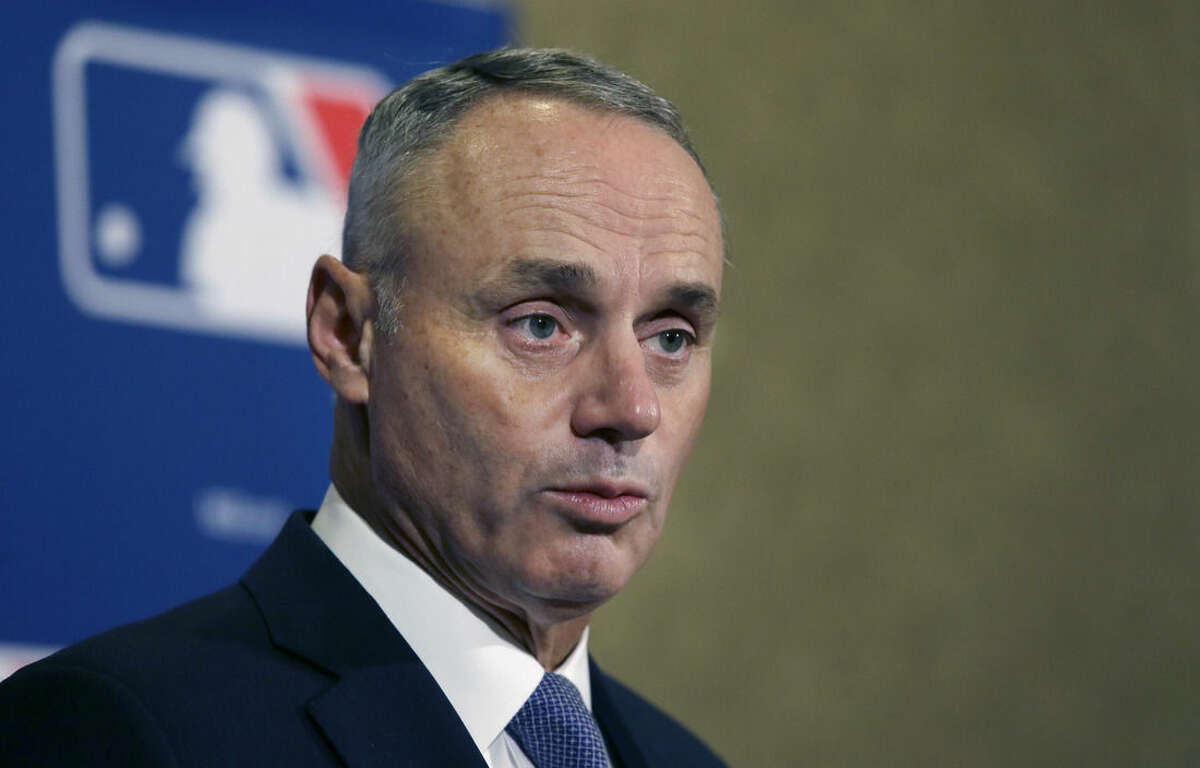 Major League Baseball Commissioner Rob Manfred speaks during a news conference after wrapping up the MLB owners meeting, Thursday, Nov. 19, 2015, in Dallas. (AP Photo/LM Otero)