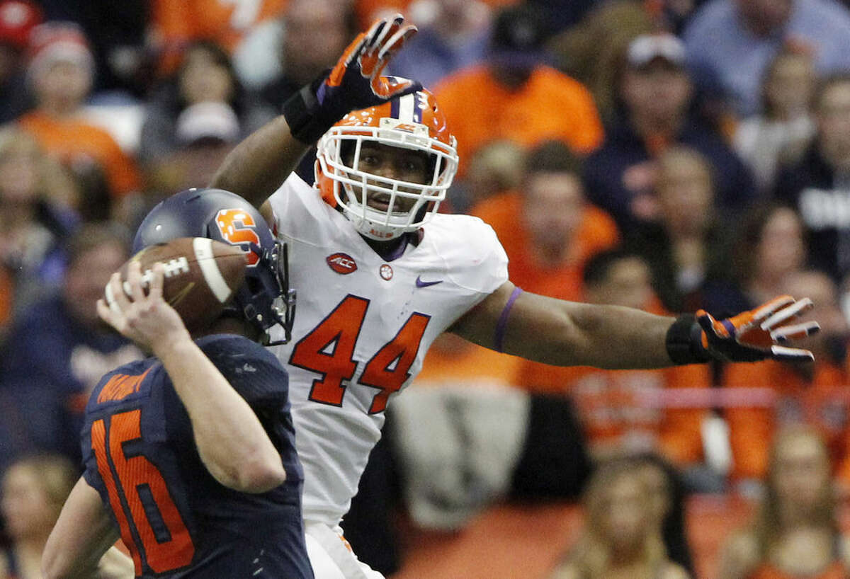 FILE - In this Nov. 14, 2015, file photo, Clemson's B.J. Goodson tries to blocks a pass thrown by Syracuse's Zack Mahoney in the third quarter of an NCAA college football game in Syracuse, N.Y. Clemson's top-ranked defense came at teams in waves last season, smothering opponents with nearly two full units of talented and experienced players. Without that same depth this year, the Tigers have slipped into a late-season slump. (AP Photo/Nick Lisi, File)