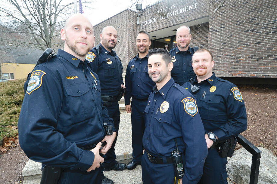 "Wilton police officers are unshaven for ""Movember,"" a national campaign to raise awareness for men's health issues. Pictured from left to right: Rob Cipolla, Stephen  Sisenstein, Frank Razzaia, Gregg Phillipson, John Patry and Robert Kluk."