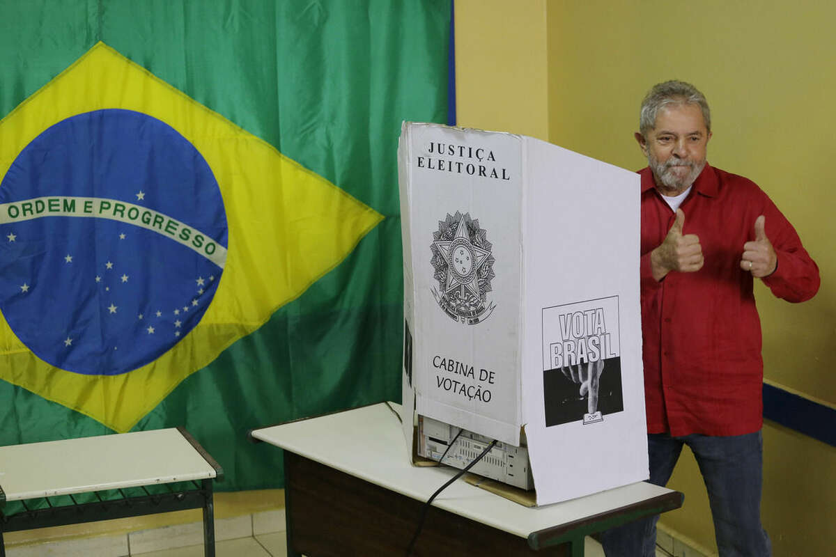 Brazil's former President Luiz Inacio Lula da Silva gives a thumbs up after casting his vote in general elections in Sao Bernardo do Campo, Brazil, Sunday, Oct. 5, 2014. (AP Photo/Nelson Antoine)