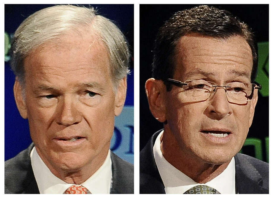 FILE - In these Oct. 2, 2014 file photos, Republican candidate for governor Tom Foley, left, and incumbent Democrat Gov. Dannel P. Malloy, right, speak during a live televised debate at the University of Connecticut in Storrs, Conn. The two men will face off in the Nov. 4 general election. (AP Photo/Jessica Hill, File)