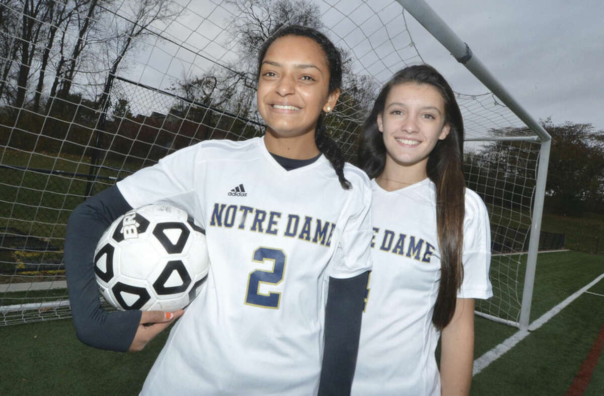 Hour photo/Alex von Kleydorff Notre Dame-Fairfield's Nazae Craw, left, and Jillian Howe, right, are from Norwalk and have helped the Lancers reach the Class S girls soccer championship game.