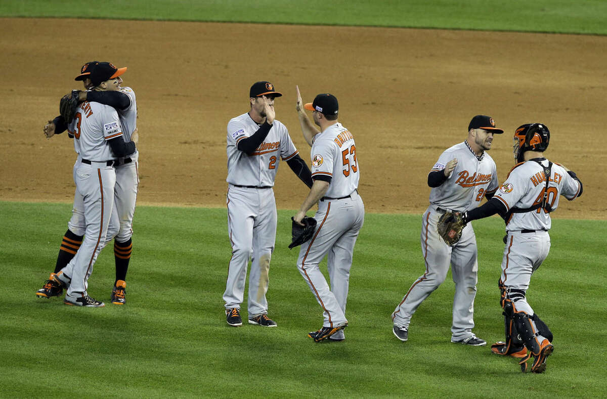 Baltimore Orioles players celebrate after defeating the Detroit Tigers, 2-1 in Game 3 of baseball's AL Division Series Sunday, Oct. 5, 2014, in Detroit. Baltimore won the series 3-0. (AP Photo/Darron Cummings)